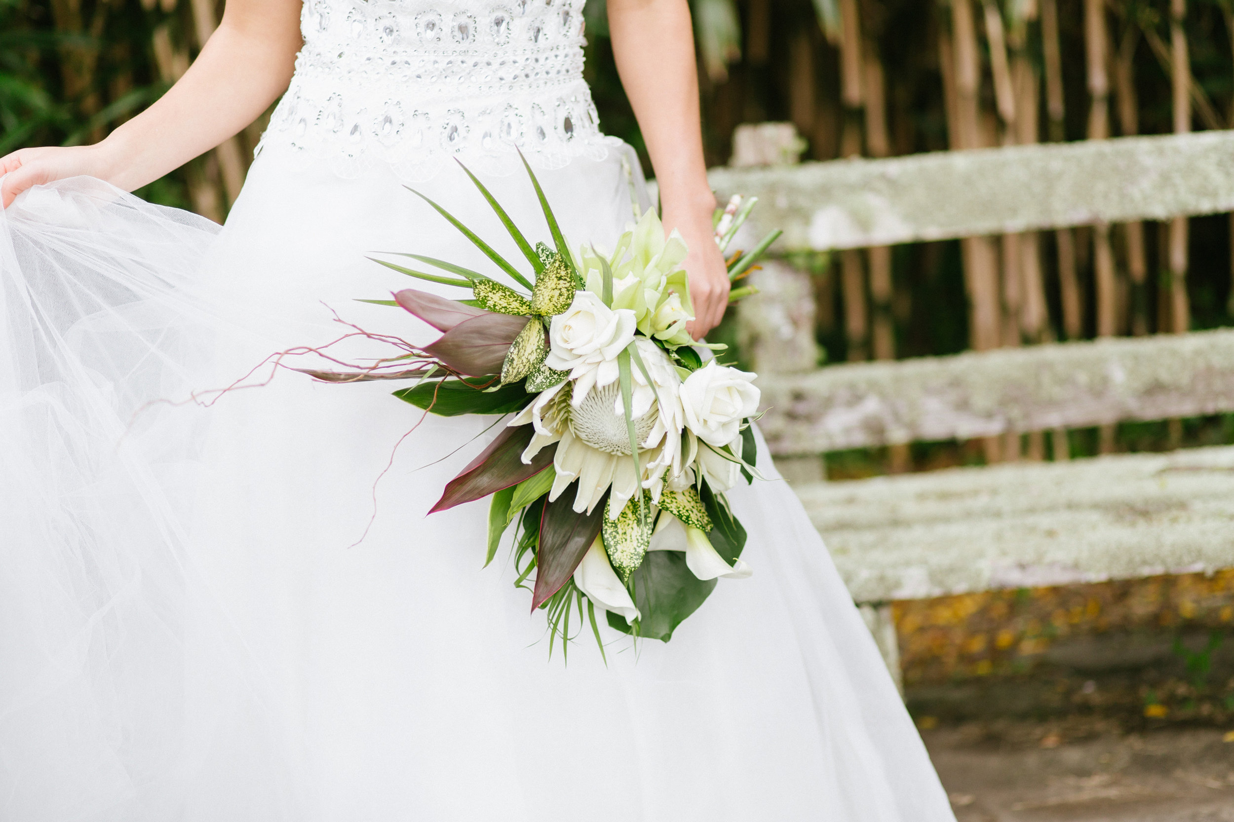 Tropical Wedding Bouquet Protea Orchids Garland Wedding Monstera Photoshoot