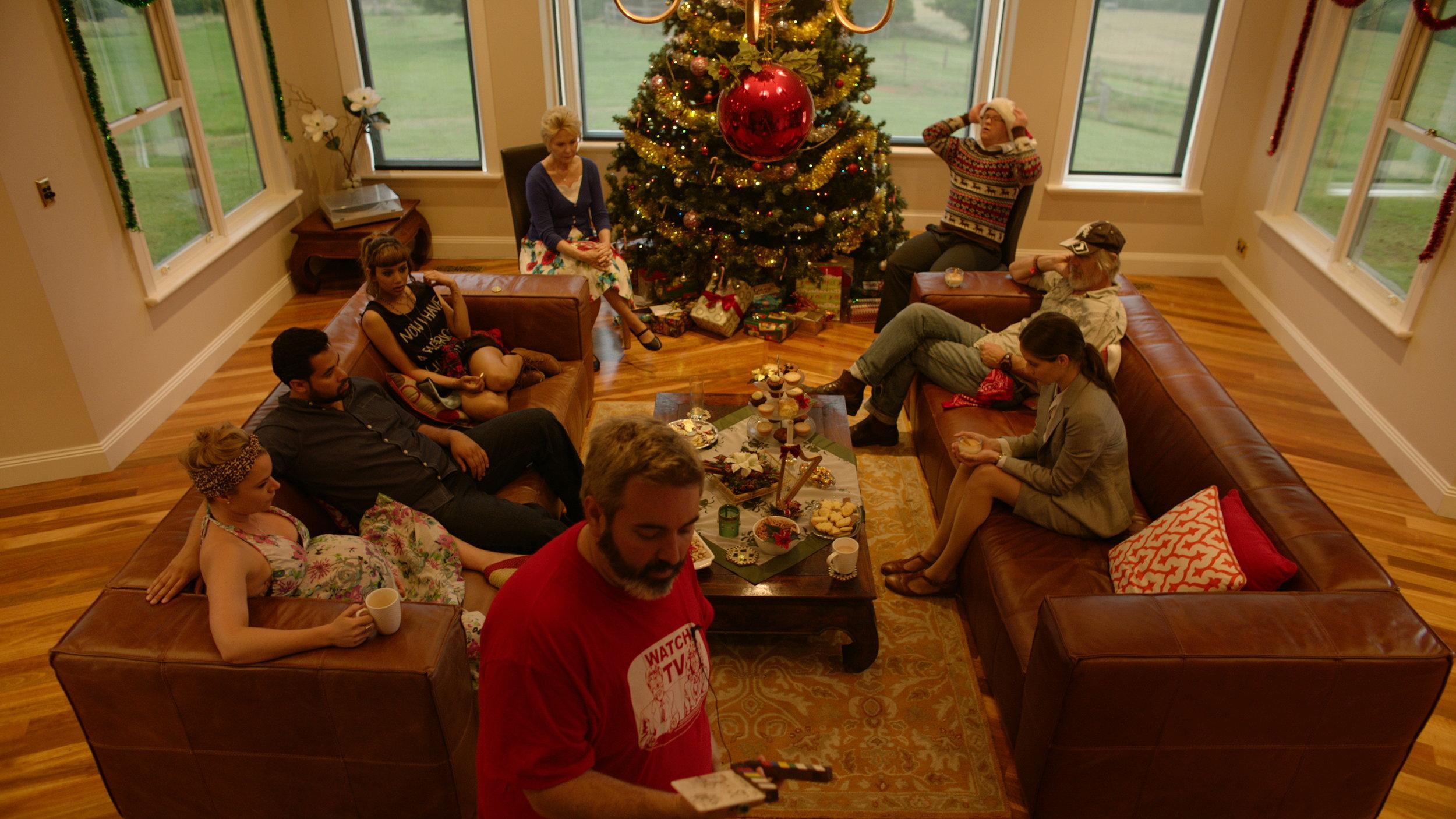 BTS - Cast at Tree w Director Craig Anderson  - Red Christmas Photo by Douglas Burdorff.jpeg