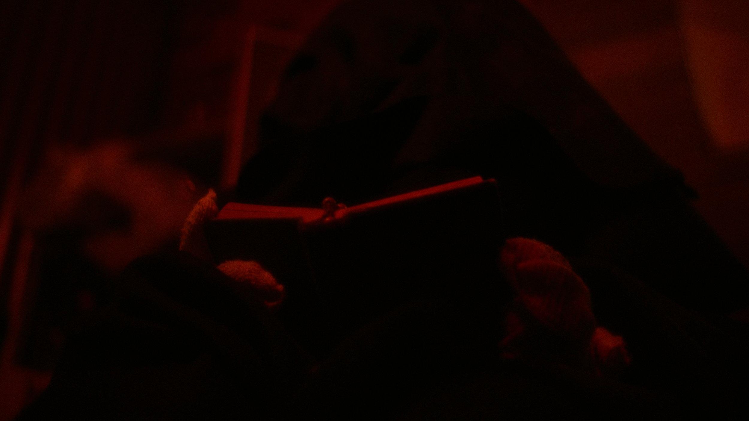 Cletus reads the bible - Red Christmas Photo by Douglas Burdorff.jpeg