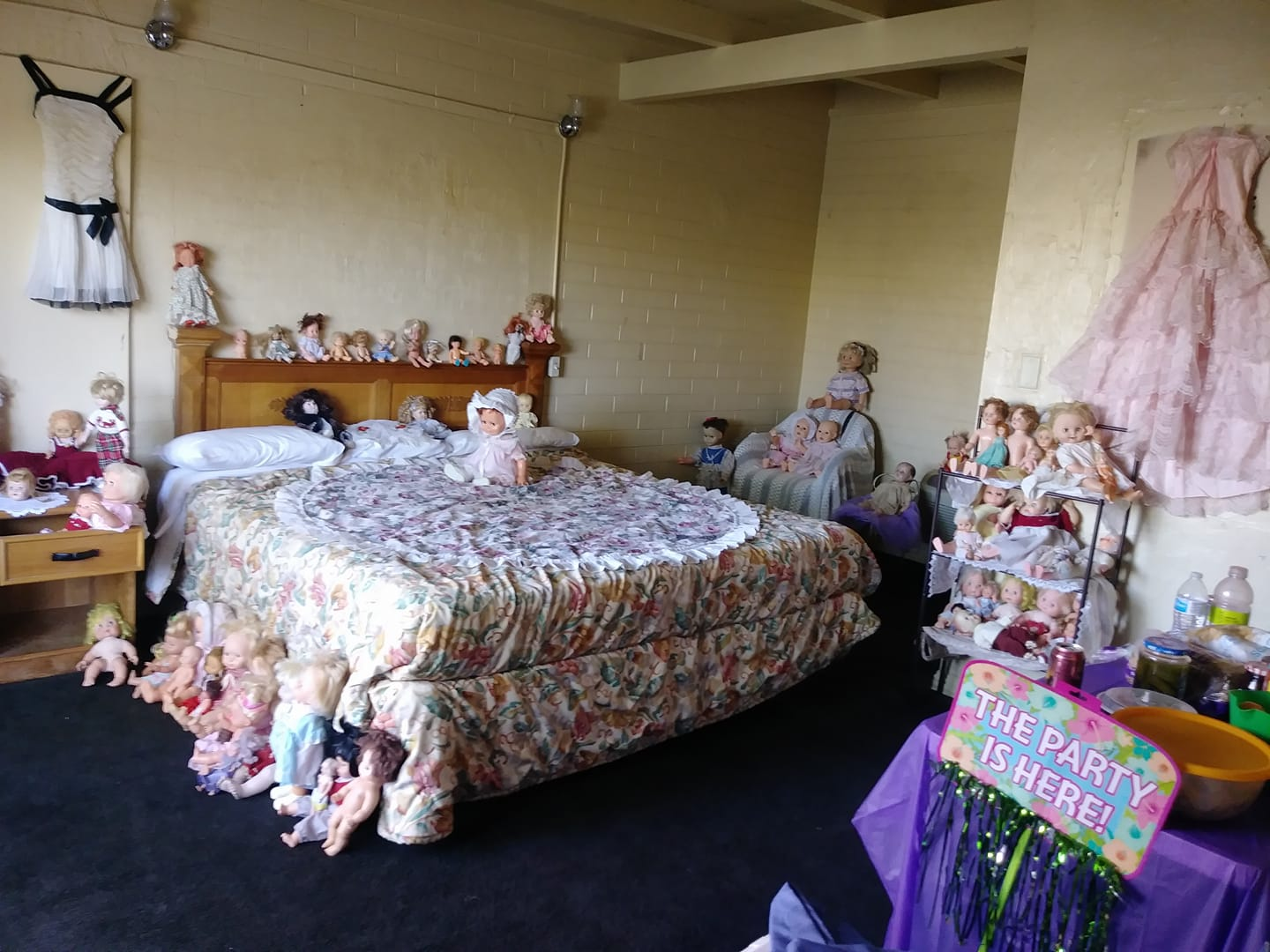 Writing is on the wall, and the bed, and the floor - Dolls. Dolls everywhere.