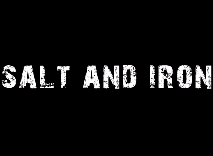 - Salt and Iron is a waking nightmare of a short, sporting an eerie -- Hammer-esque -- electronic synth style score, and minimal dialogue. In fact, what bit there is, would probably not be missed at all if removed, especially given how much is done with the rest of its aural elements. Visually, the film is dressed with floral serenity, and shot from the perspective of the male gaze. The women are played as seductresses, using their body language to tempt and lure, poetically turning the fisherman into a fish. If there's anything to be said about George James Fraser's work, it's that each new endeavor demonstrates a marked improvement in various aspects of filmmaking. Salt and Iron is no exception. Here, Fraser weaves a dark-fantasy horror story involving a gruff, drunk, fisherman that happens across the woman of his dreams -- or so he thinks. Without giving too much away, as more of these back-wood-boggy-sirens begin to show up, our delirious drool bucket of a protagonist begins to suspect that perhaps he should have played this one as a catch and release.Look for the premiere of Salt and Iron at the upcoming Happenstance film festival, June 12th. Certainly a fantastic way to kick off the night.