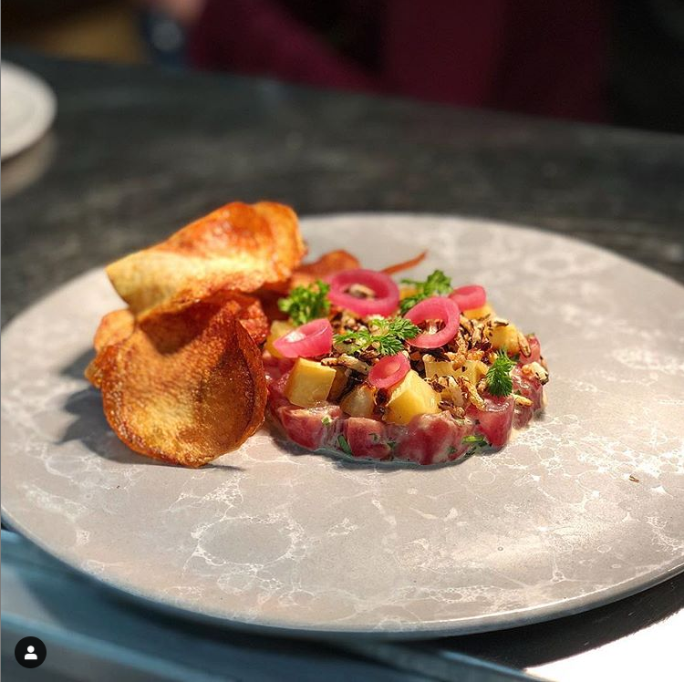 Yellowfin Tuna Tartare ; ponzu aioli, puffed rice, avocado purée, smoked pineapple, pickled cipollini onion,dill pickle chips.