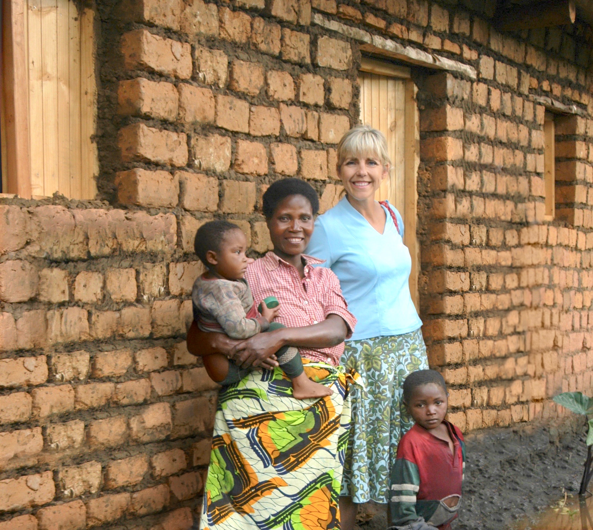 Odette and TVM Executive Director, Diana Wiley, in front of Odette's new home