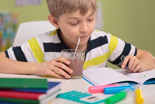 child drinking through a straw happy