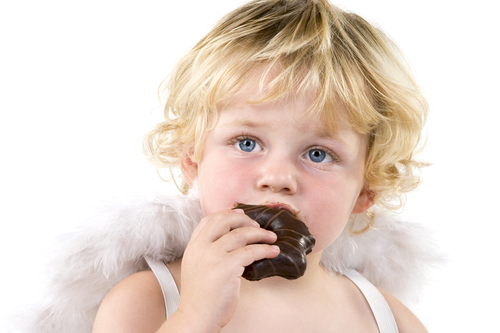 Angelic child eating snack