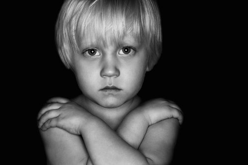 black and white photo of unhappy boy