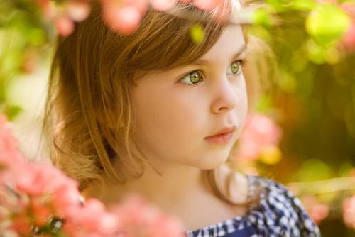 Little girl looking off wonderingly