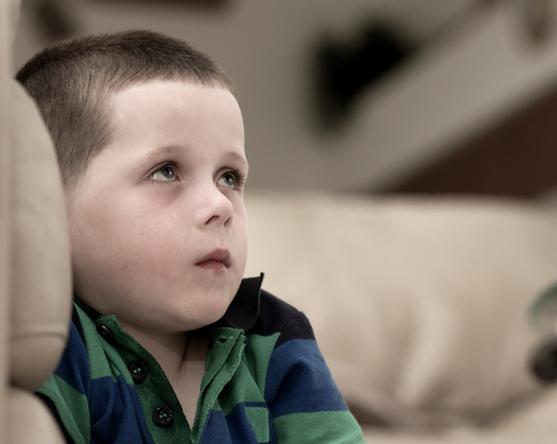 Child looking up remorseful
