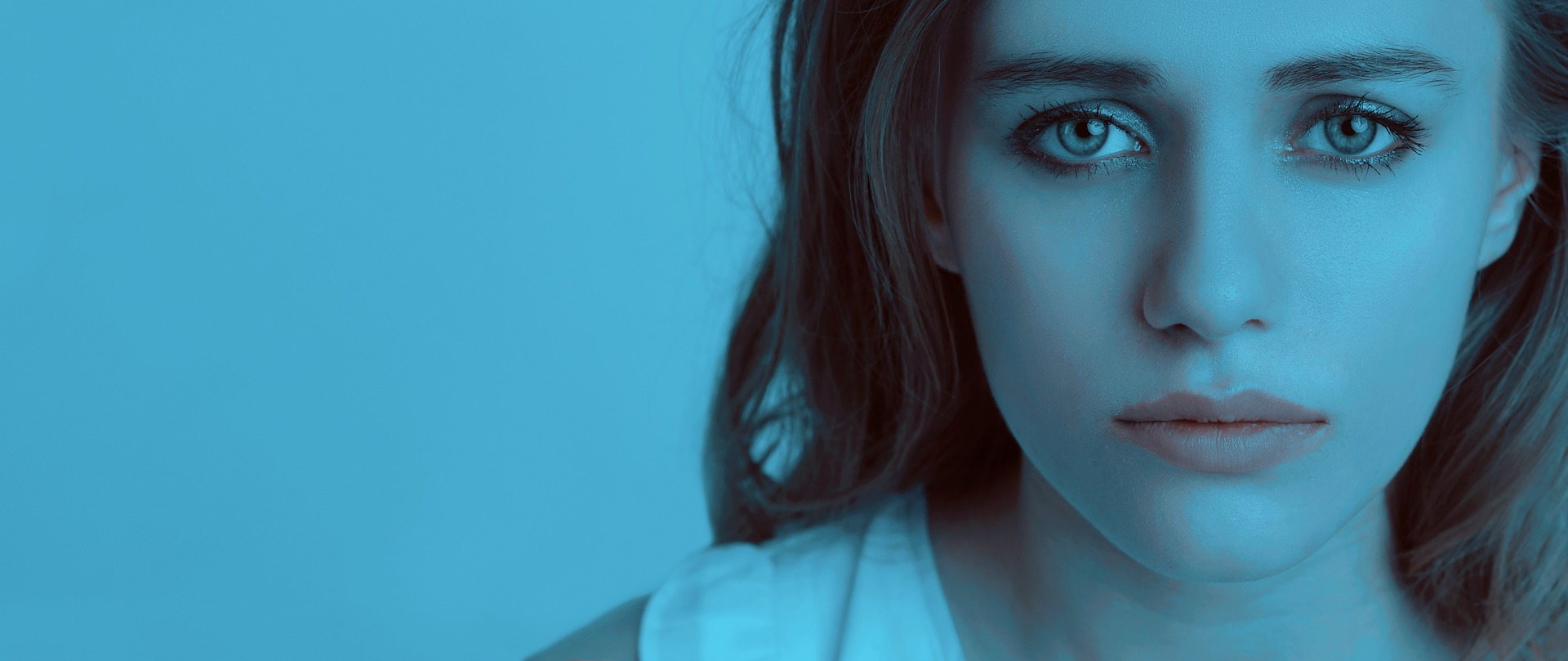 woman looking sad with blue tint
