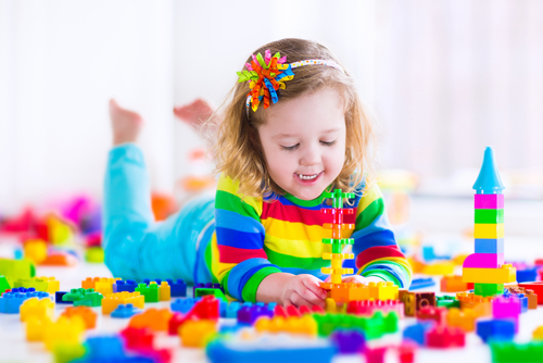 little girl playing with legos