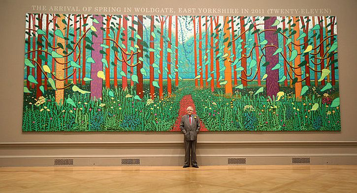 David Hockney standing before the Arrival of Spring. Source:  A Bigger Picture