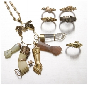 A selection of hand motif jewelry. Live Auctioneers.