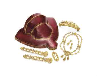 AN ANTIQUE GOLD PARURE   Comprising a sculpted gold necklace of foliate motif; two bracelets, a brooch, a pair of ear pendants and a tiara en suite, circa 1830, necklace 17½ ins., bracelets 7 ins., with French assay marks, French importation marks and maker's marks, in a red leather fitted case (6)   Christie's Sale 2694