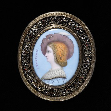 Paris, c. 1862   Brooch, painted porcelain plaque, inscribed, open silver mount with enamel decoration, set with garnets.   V&A Museum