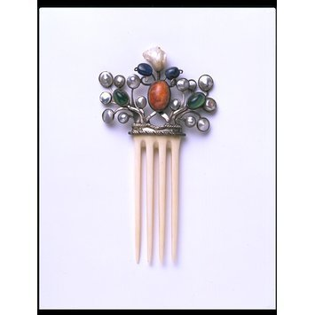 England, 1906   Hair comb, ivory, mounted in silver and set with mother-of-pearl, sapphires, green stained chalcedony and a fire opal matrix (Arts & Crafts)   V&A Museum