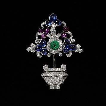 Paris, c. 1927-1940   Ostertag   Brooch platinum, white gold, baguette- and brilliant-cut diamonds, rubies, sapphires and emerald   V&A Museum