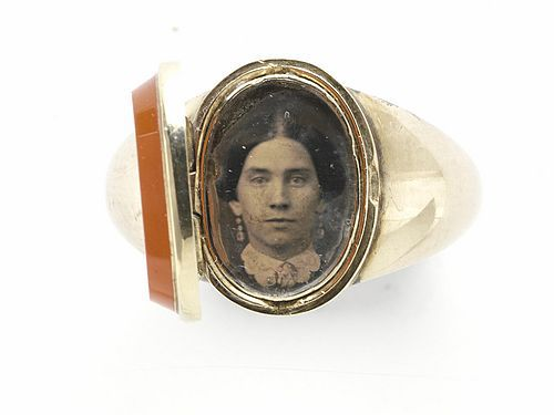 Man's oval ring with a Daguerreotype of a lady inside, agate cover   1850 (ca)   Jewelry, Daguerreotype   Private collection of Larry West   Courtesy of Larry J. West, © West Companies, Inc., 2005. [From the book: Tokens of Affection and Regard]   LL/8603