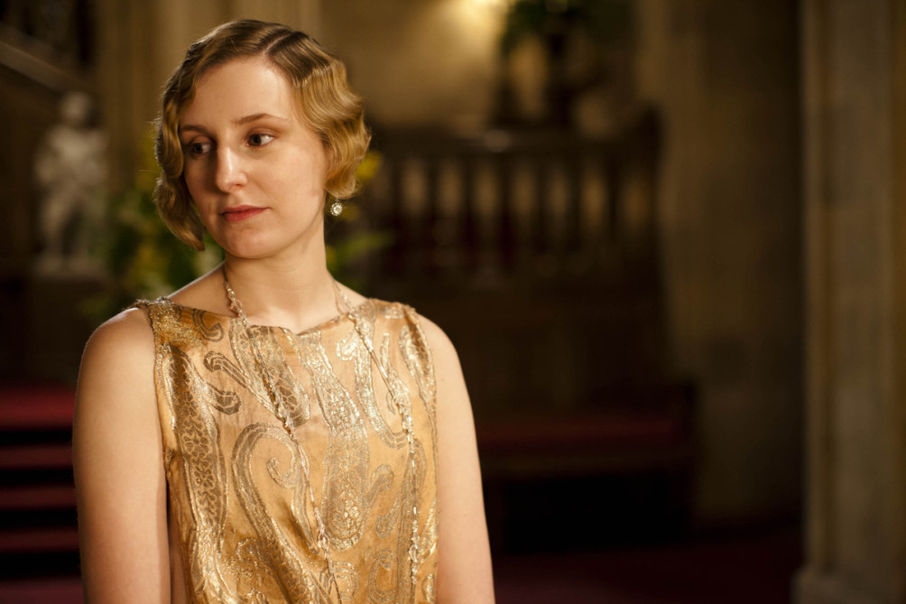 Lady Edith wearing very long delicate chain.