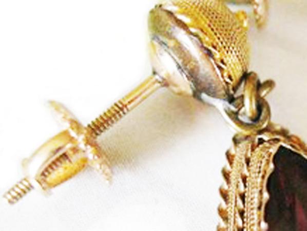 Detail of screw-back earrings.