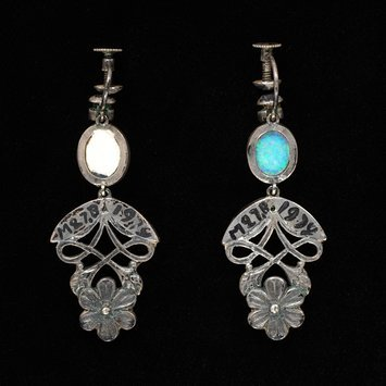 London, 1934   Earrings with silver, opals, rubies and stained chalcedony   Showing screw back for non-pierced ears   V&A Museum