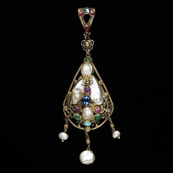 England, c. 1900   Pendant gold openwork, gold openwork, pearls, blister pearls sapphires, emeralds, rubies, moonstone, turquoise.   Henry Wilson   V&A Museum
