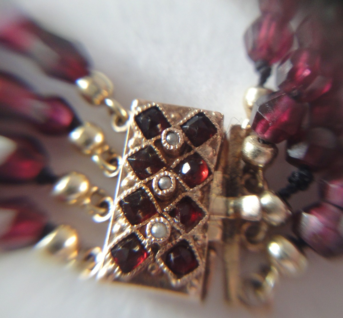 Victorian garnet bracelet with rose gold and seed pearls.