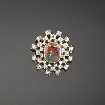 An early 19th century diamond locket brooch   Of old brilliant-cut diamond starburst design, the central locket compartment enclosing a later fishing fly, circa 1820Christie's Sale 5642