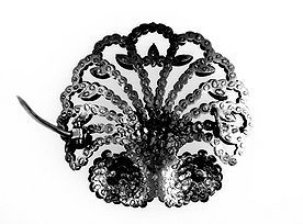 Scallop Shaped Cut-Steel Brooch: Reverse. Note the Pattern of Rivets Securing the Studs.   © The Trustees of the British Museum.