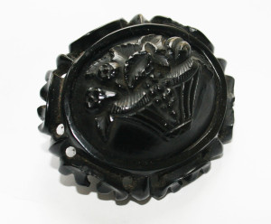 Carved Whitby jet brooch, late Victorian. (This brooch is showing some slight damage around the edges).