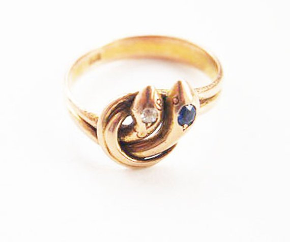 Mid to late Victorian gold duel serpent ring set  with diamond and sapphire