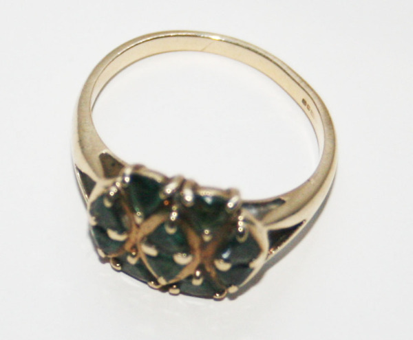 A naturally mined Alexandrite and 9 ct English ring from my personal collection. Judging by the Art Deco setting, I would place this ring from 1920 to 1940. It was hard to capture the colors with my camera, but the stones change subtly from dark green to dark purple in daylight.