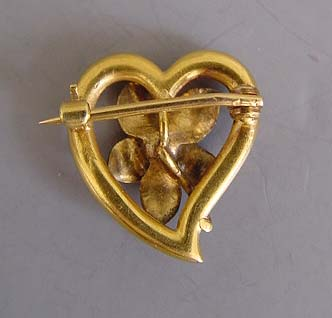 Morning Glory Antiques. This brooch is post-1901 and pre late 1920s.