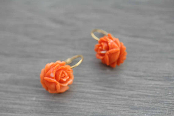 Carved coral and gold earrings. Probably Art Deco. Elder and Bloom.