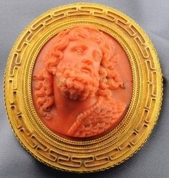 Fine Antique Coral Cameo Brooch within a Frame Accented By Greek Key Motifs And Applied Ropetwist Borders, With Pendant Hook, Mounted in Gold c.1801-1908 Prices4Antiques
