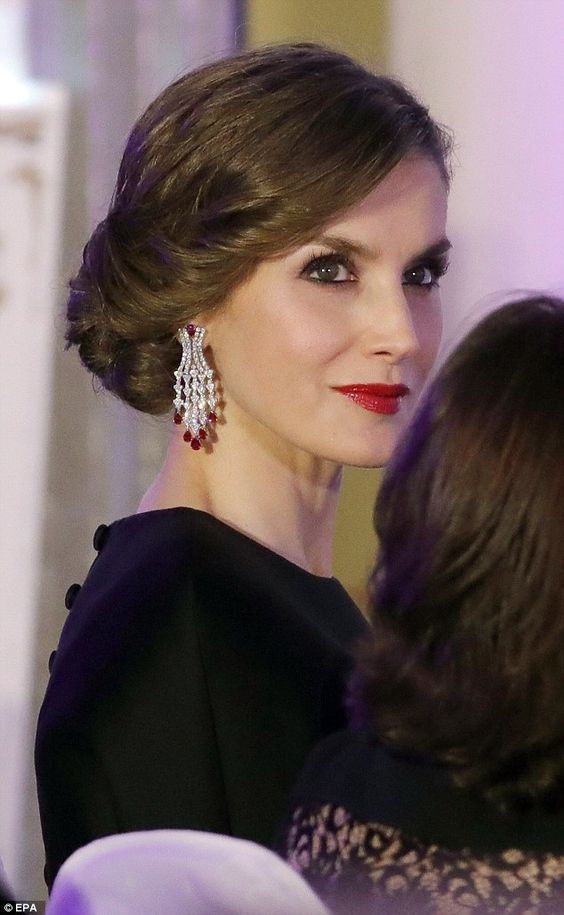 Queen Letizia of Spain wearing chandelier style earrings.