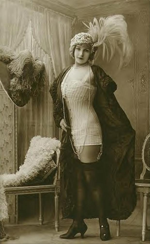 Risqué Edwardian lady wearing a sautoir necklace and an aigrette.