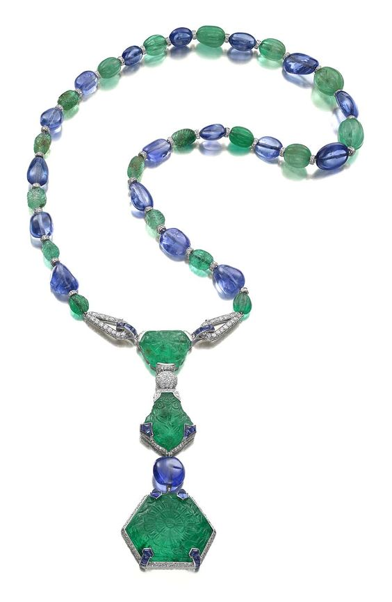 The Cartier Timken necklace, designed in 1925. It is one of the most important examples of Cartier jewellery from the Art Deco era. It is set with three rare Mughal emeralds carved on the front and reverse weighing 71.91ct, 30.27ct and 29.21ct, sapphire beads, buff-top cabochon sapphires, emerald beads and diamonds