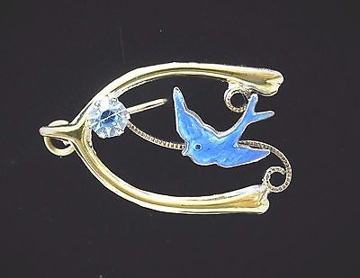 A blue bird or swallow with a wishbone was a common design, signifying 'Wish for lasting love'