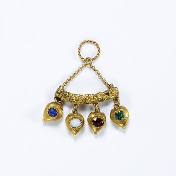 England, c. 1830 Pendant, gold with lapis lazuli, glass in imitation of opal, garnet, emerald and gold. Here, the pendant has the stones of Lapis Lazuli, glass in imitation of Opal, Vermeil ( the old name for garnet ) and Emerald which spell LOVE. V&A Museum