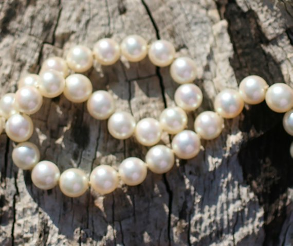 A flawless, stunning and very fine vintage Princess length Mikimoto Akoya Saltwater Pearl Necklace with 14 karat white gold clasp.