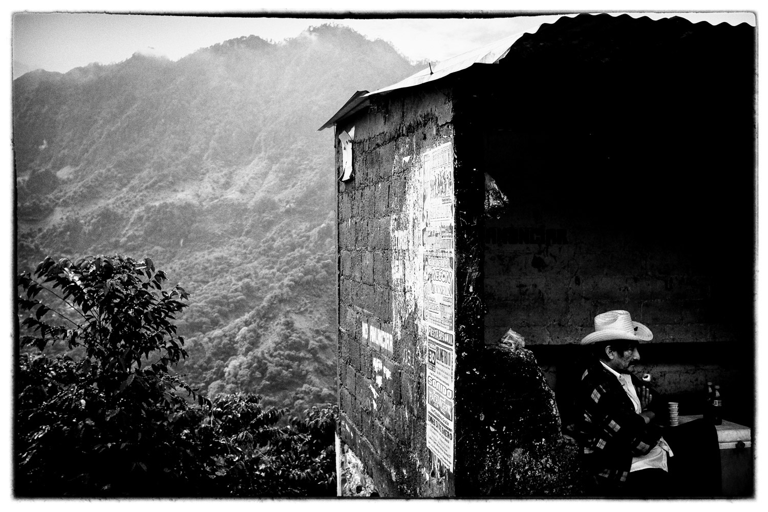Along the mountain road to Teocelo, Veracruz, Mexico, a retired coffee worker sells Coca-Colas from a roadside shelter. Photo by Andrew Sullivan