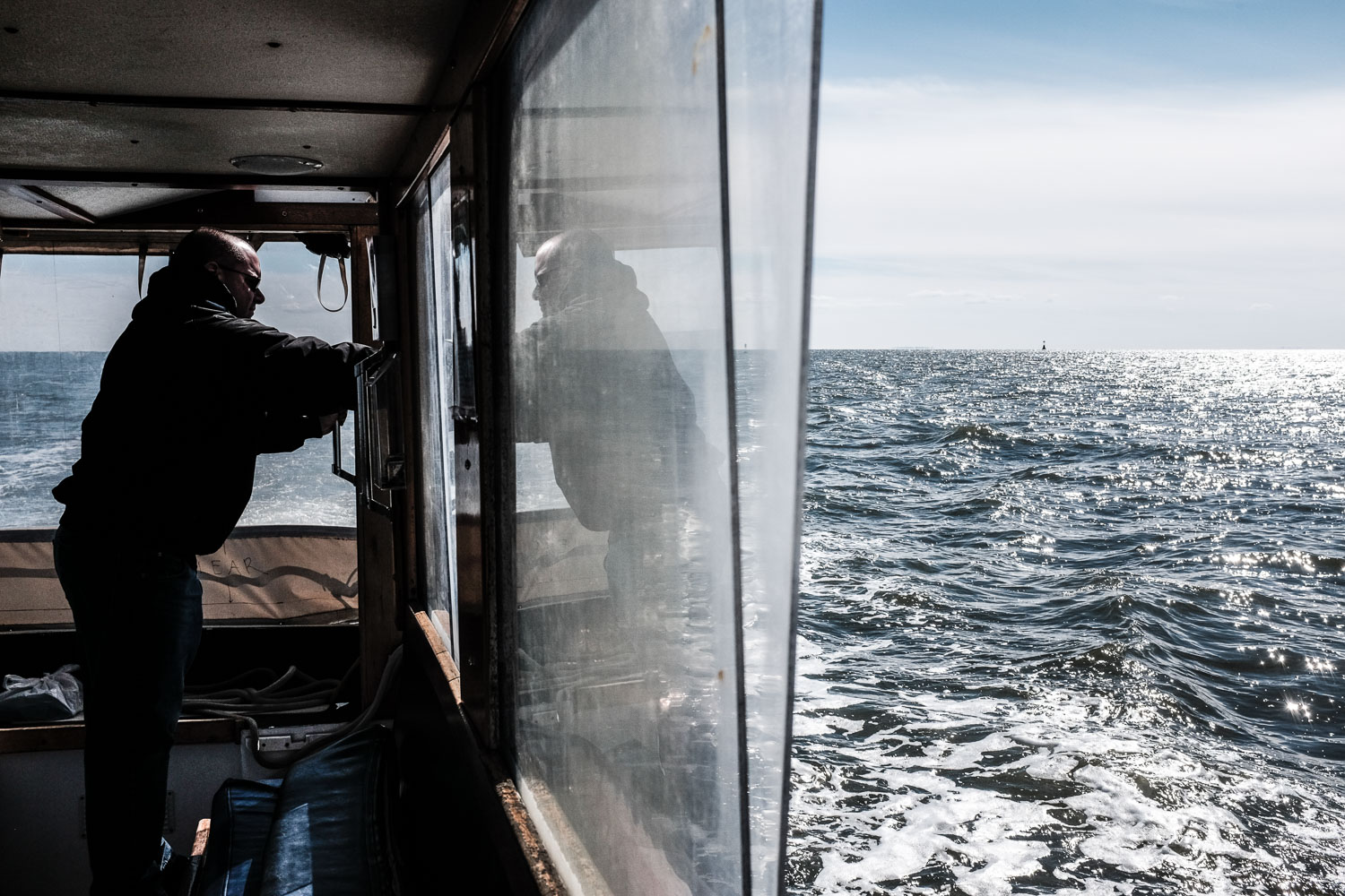 First mate Justin Infantino aboard the Sea Mist off the coast of Branford, Conn. Andrew Sullivan for The New York Times