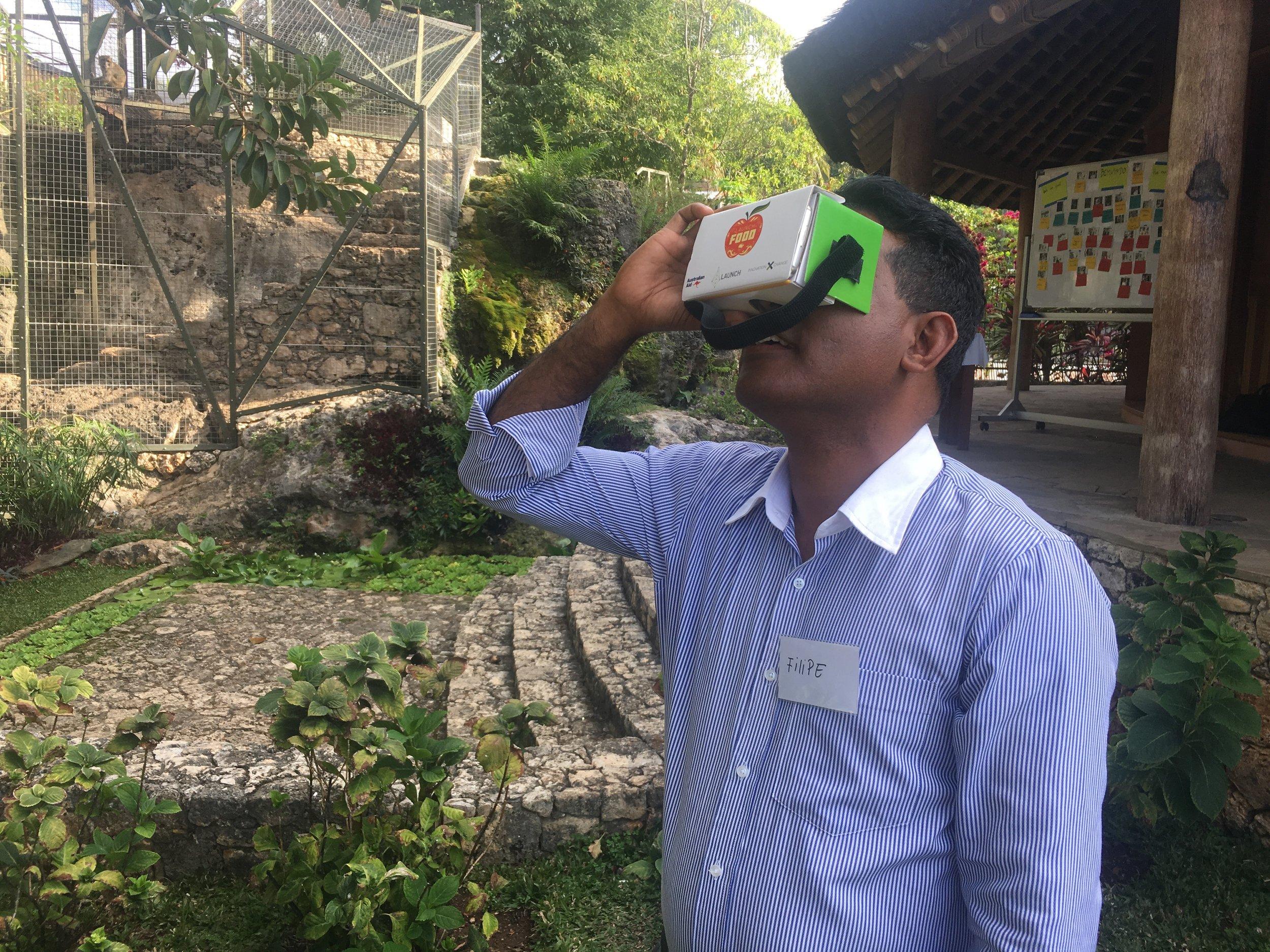 Presidential Advisor Sr. Filipe da Costa engaging in a VR experience in Baucau, Timor-Leste photo by Davar Ardalan