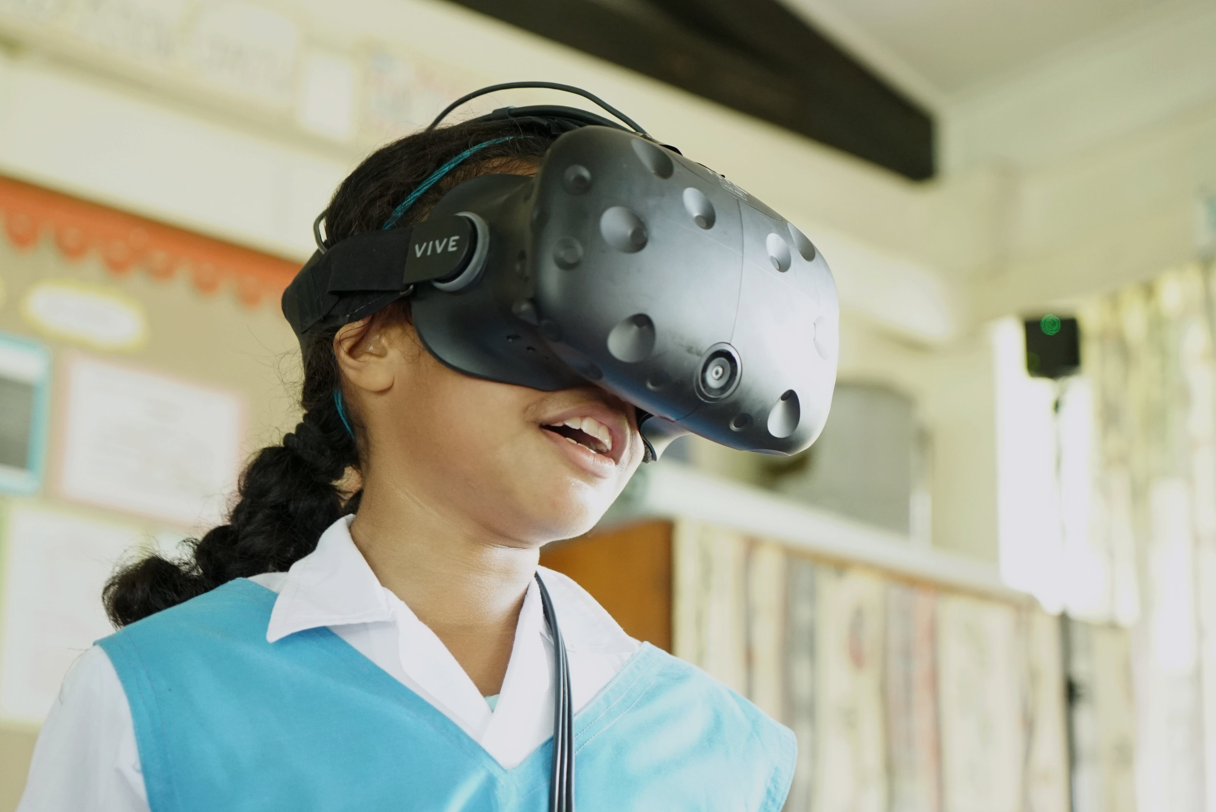 A student from Stella Maris Primary School in Fiji tests the BTS VR experience