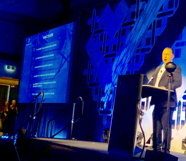 Nathan Pettyjohn welcomes the crowd at the VR/AR Global Summit in Vancouver, September 21, 2018