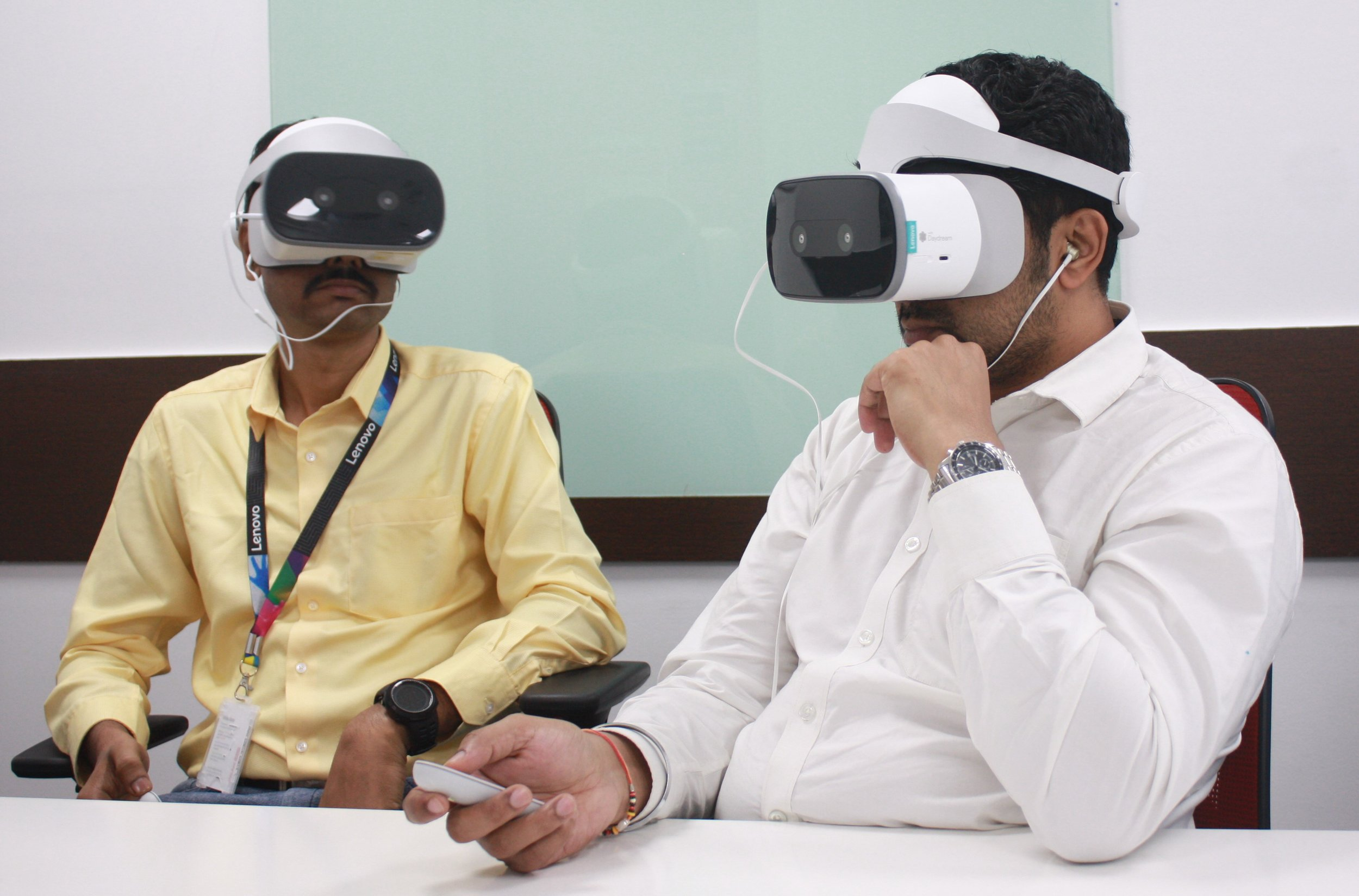 New employees in Asia Pacific learning about Lenovo and its culture with virtual reality Mirage Solo headsets.