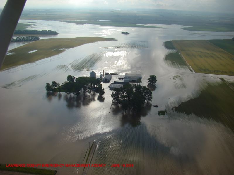 An Illinois farm swept by floodwaters.