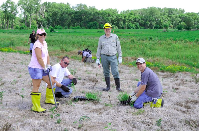 Wade Spang of the U.S. Forest Service and Waste Management volunteers at Midewin.