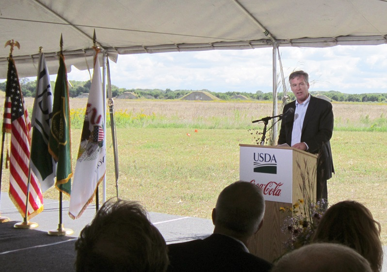 With old Army ammunition bunkers visible in the background, a reminder of Midewin's history of landscape alteration, Coca-Cola Americas President Steve Cahillane announced the new water replenishment partnership on September 13. Photo by Vera Leopold/TWI.