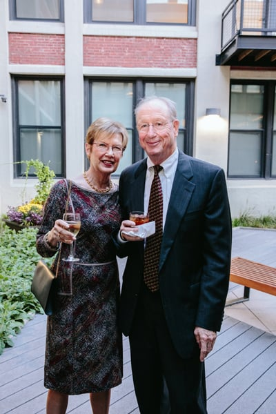 TWI Board Member Bill Dooley and his wife, Willie, enjoy cocktails in Greenhouse Loft's courtyard.